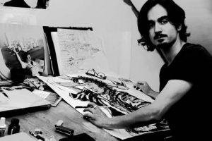 Portrait de Bastien Loukia sur la table de son atelier de BD
